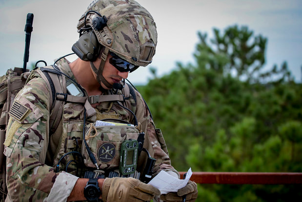 Soldier reviewing data on notes